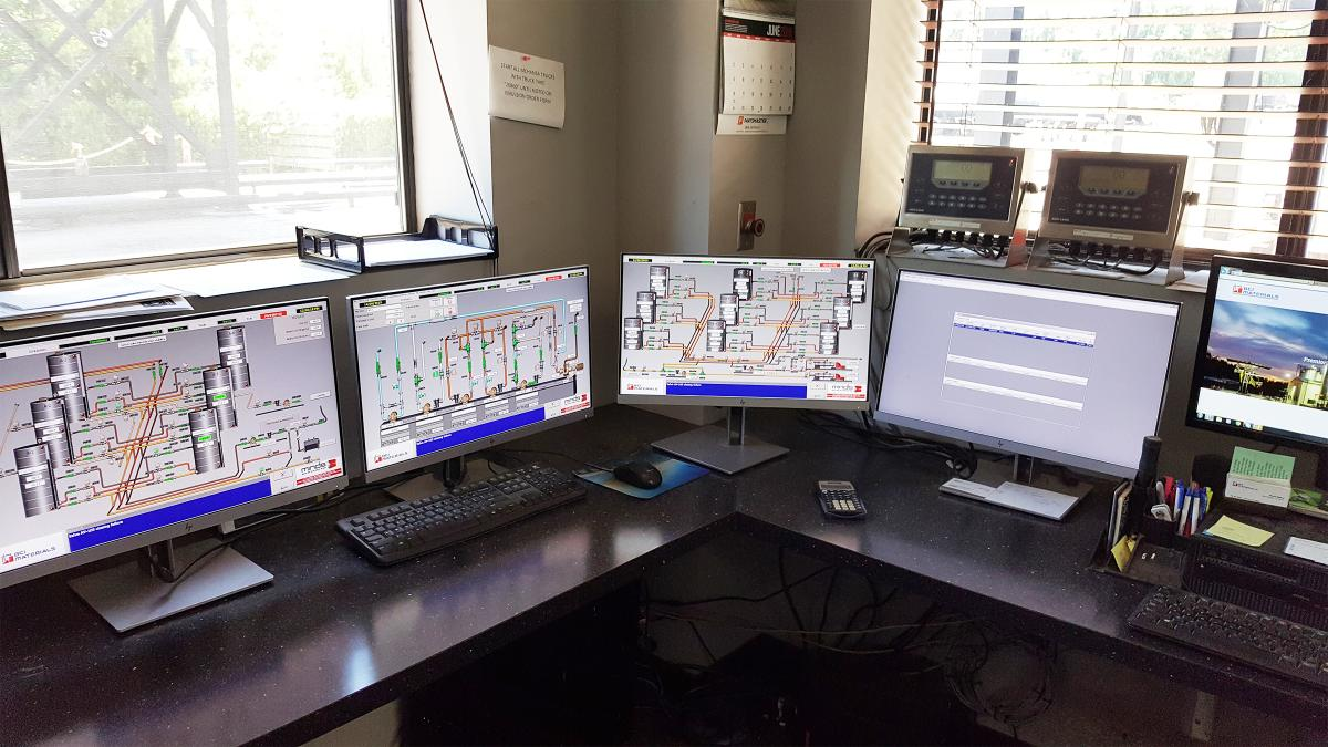 The monitors at Blythe Construction emulsion plant display four elements of MINDS' EmulTronic plant control system and its Tessera software for loadout and ticketing.